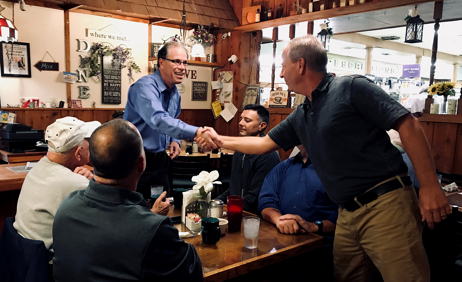 Senator Mike Braun meeting and shaking hands with constituents